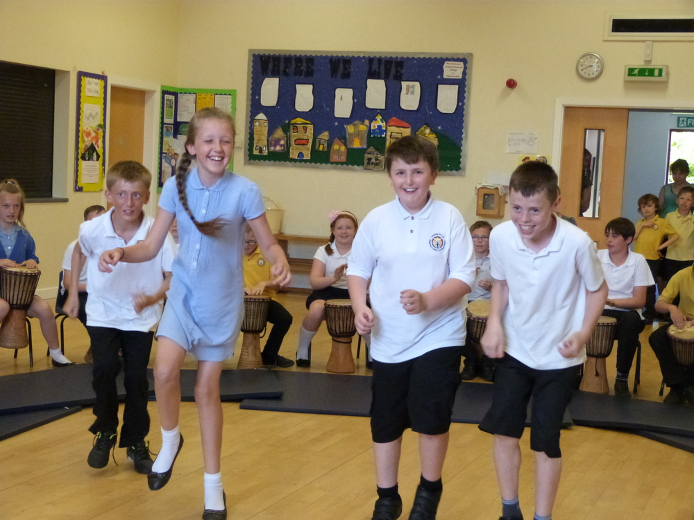 Primary school students dancing during an African Drumming Workshop by Unbeatable Energy - Chapel en le Frith, Derbyshire