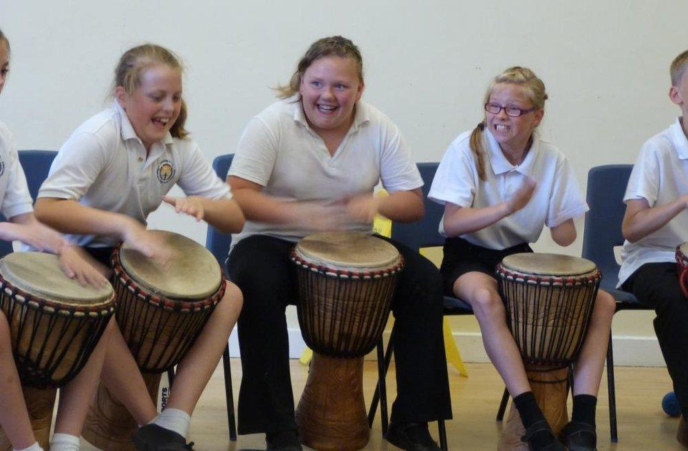 African drumming creates smiles in schools