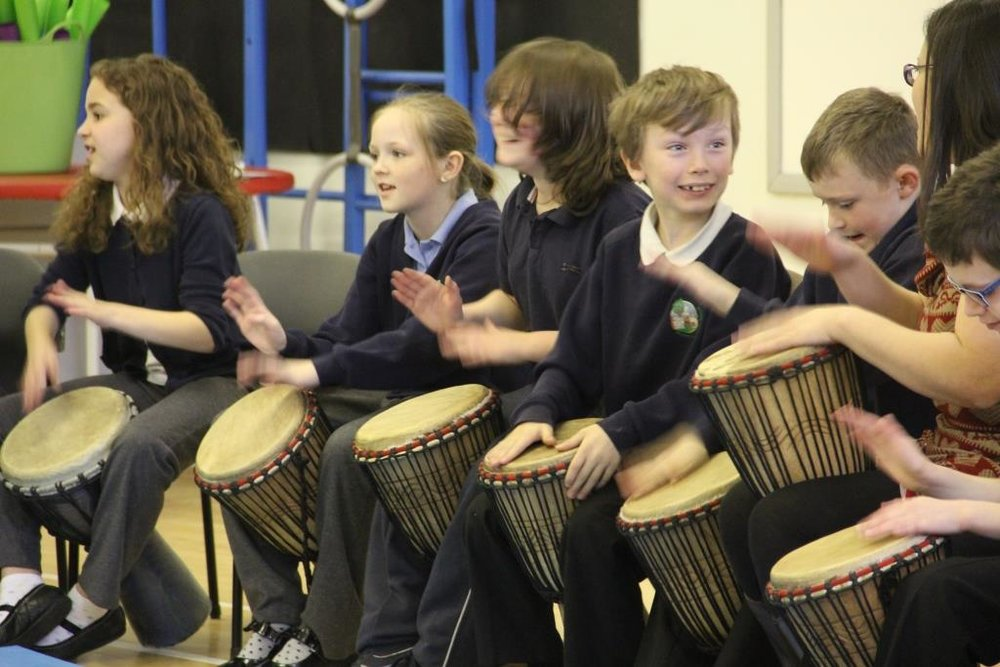 Use vocals to teach African Drumming to school children