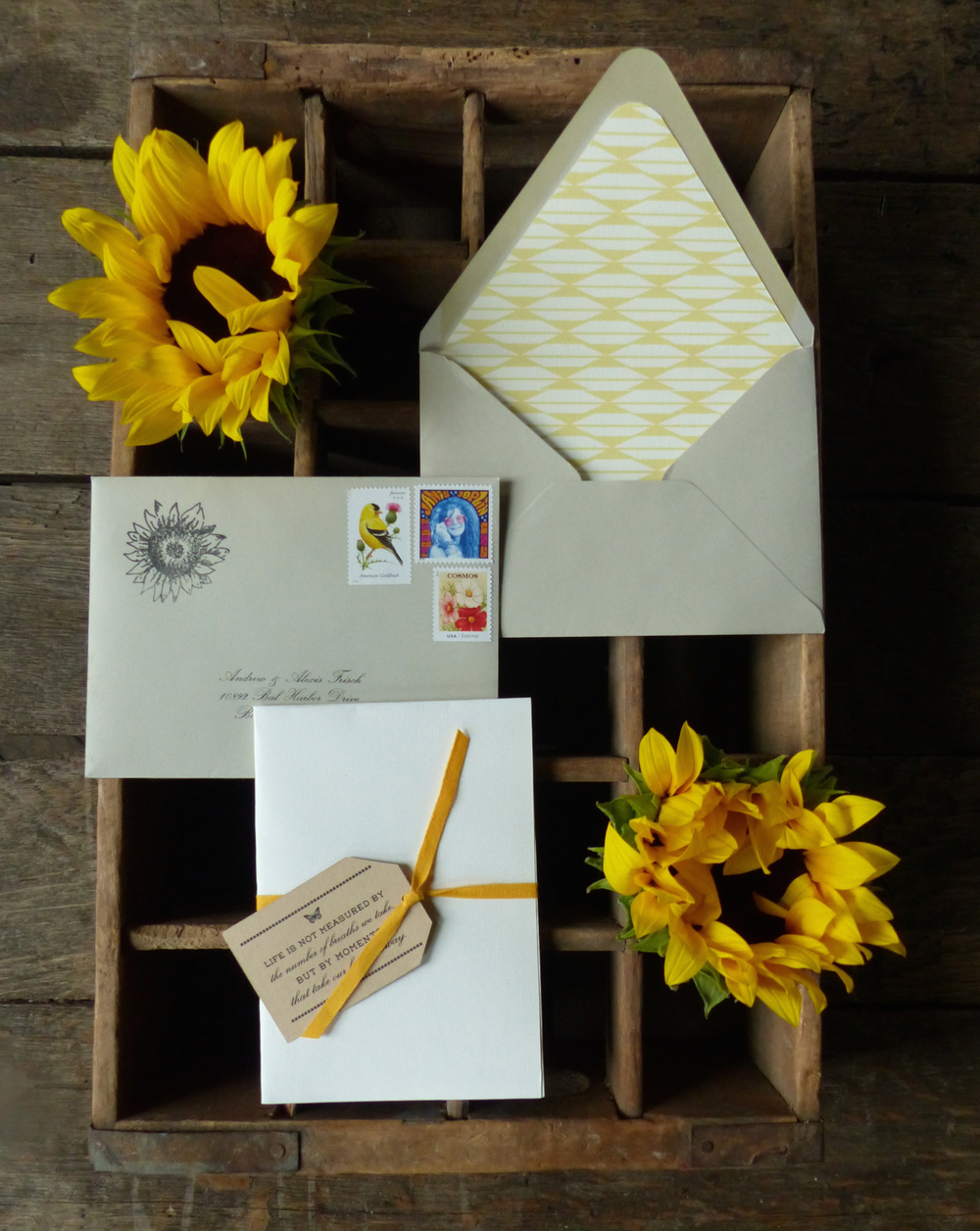 The invitation was delivered folded up inside of a regular old envelope, and bound with a sunny yellow cotton ribbon and tag.