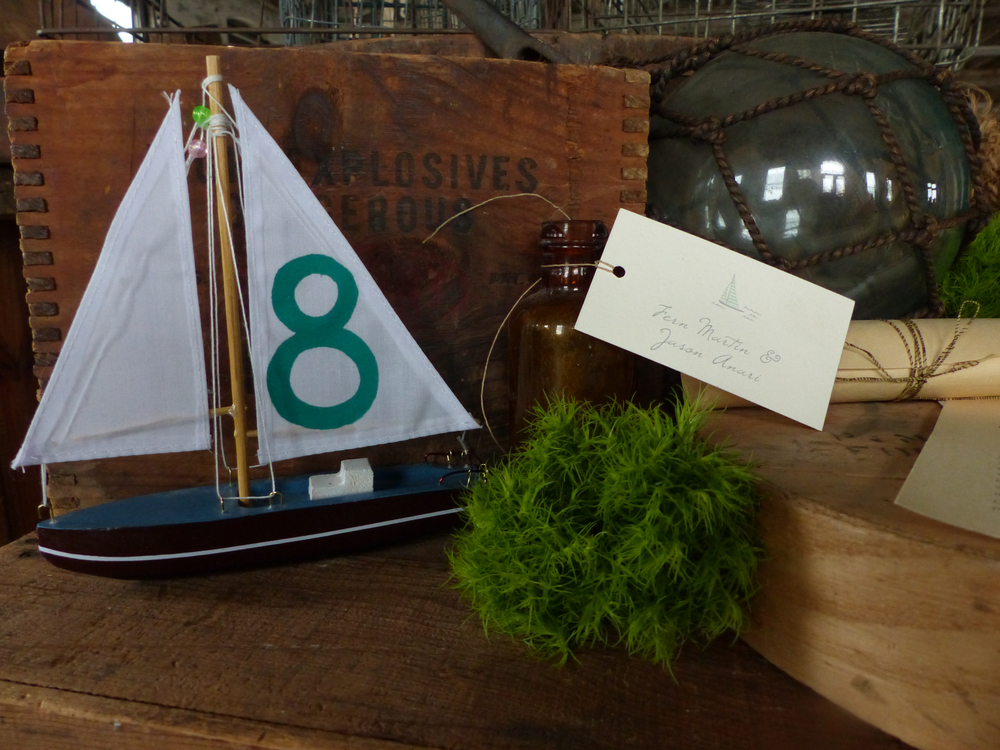 For table numbers we painted the sails of model boats.