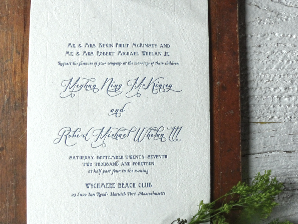 The classic beachy letterpress invitation was first blind impressed with a nautical map of Cape Cod Bay