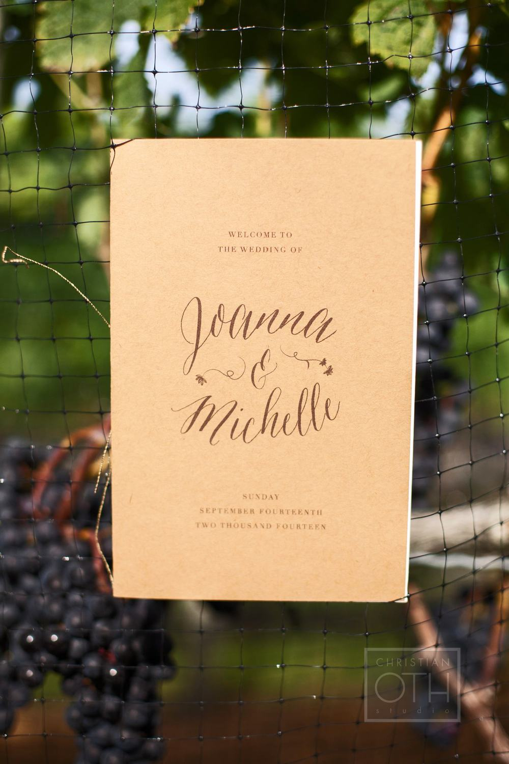 """Day Of Wedding"" pieces include a rustic ceremony program printed with the couple's logo."