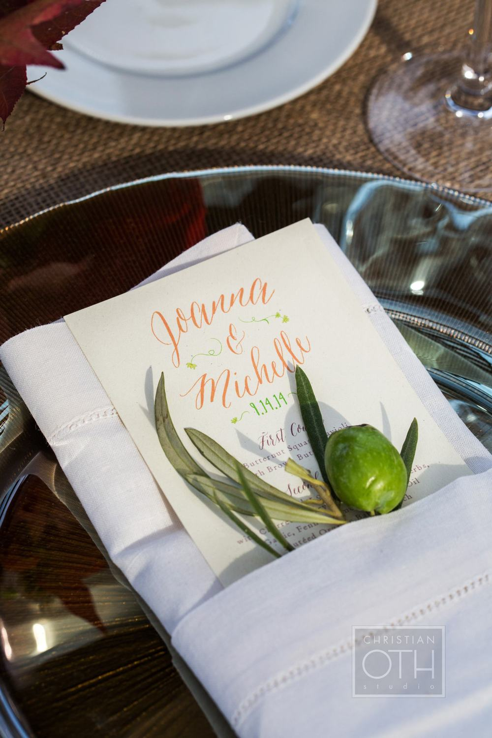 Other day of pieces include a menu cut to fit inside a folded napkin and simple flat place cards which were pinned to olive branches for display.