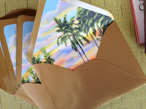 The metallic gold envelope was lined with a vintage tropical sunset scene lending just a wink of tropical kitsch.