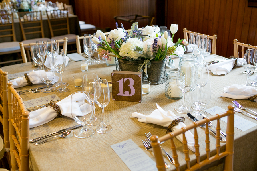 Table numbers were hand painted in lavender on wooden blocks.