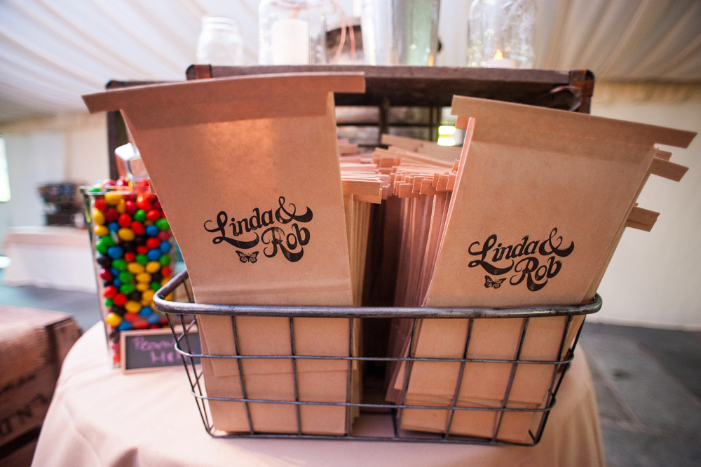 Tin tie bags stamped with the couple's logo were provided for the expansive candy bar.       Additional photography provided by   Shari Silk of Silk Studios