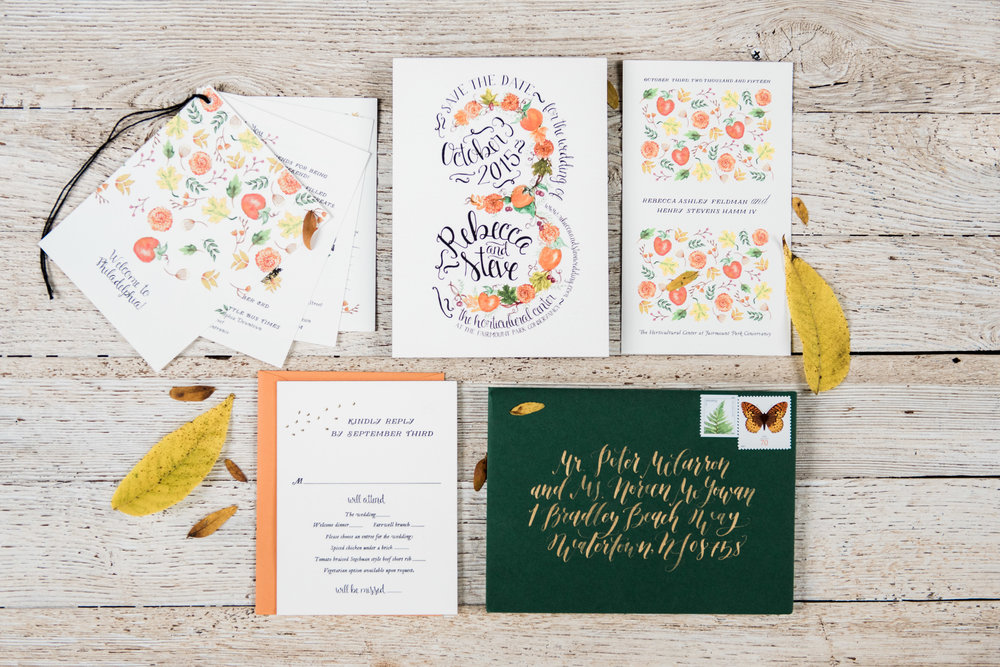 The floral and fruit motif used on the save the date was carried all the way through the day of materials like the welcome packet and ceremony card. To balance and this adorable fun we used classic black letterpress and a forest green envelope with elegant gold calligraphy
