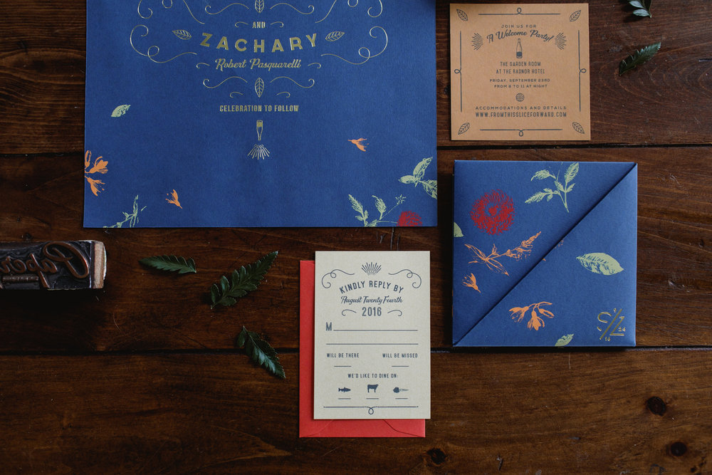 Detail of royal blue invitation suite with cream reply card for a fall wedding.