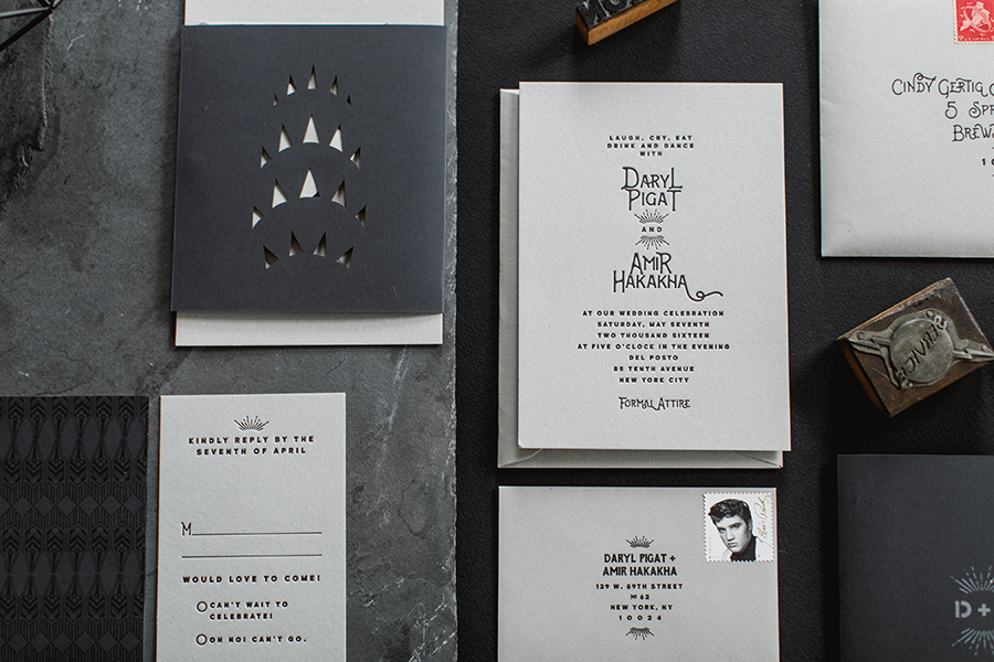 Daryl and Amir favored a monochromatic color palette in shades of gray and black. We created a folder out of rubberized paper with a laser cut peek-a-boo likeness of the top of the Chrysler Building to wrap around the cards.