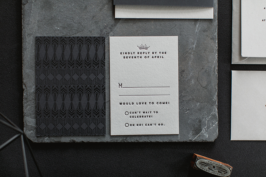 We duplexed the reply card with the same black rubberized paper we used for the folder and printed a custom art deco pattern with clear gloss for a very subtle effect.