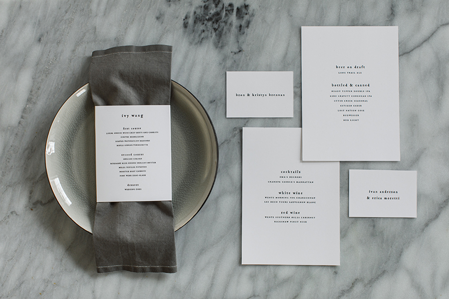 Day of wedding items followed suit with minimal black type on crisp white.