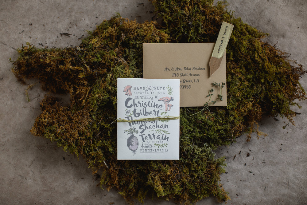 "The save the date we created was actually a seed packet that contained thyme seeds giving a nod to the location. We tucked in a wood plant marker with the words ""Good Thymes"" just to be punny!"