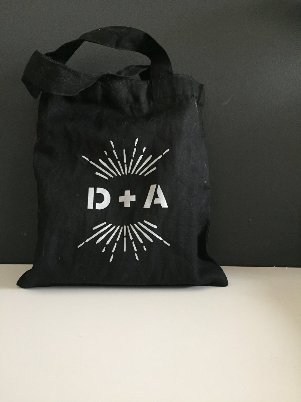 The logo carried all the way through all the day of pieces including these cotton tote bags for guests' hotel rooms!