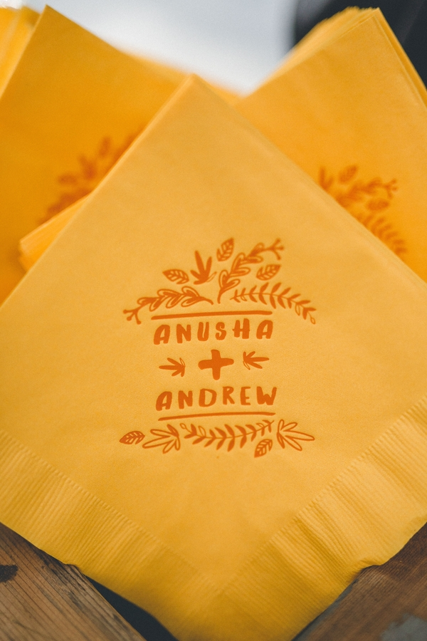 Turmeric colored napkins with the couple's imprinted logo accompanied refreshing signature cocktails.