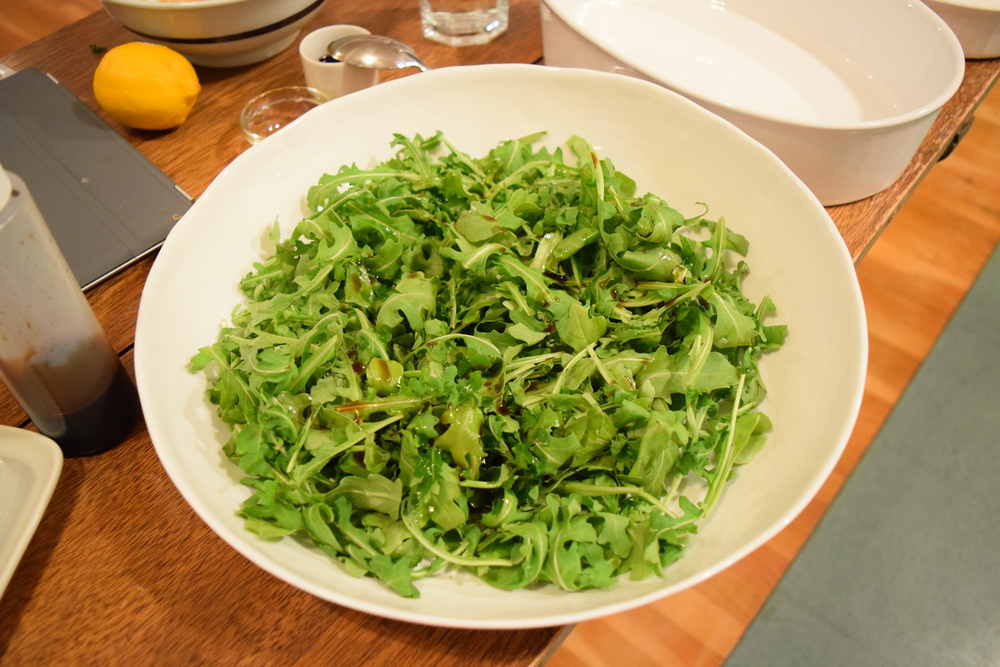 Toss arugula with balsamic and olive oil.