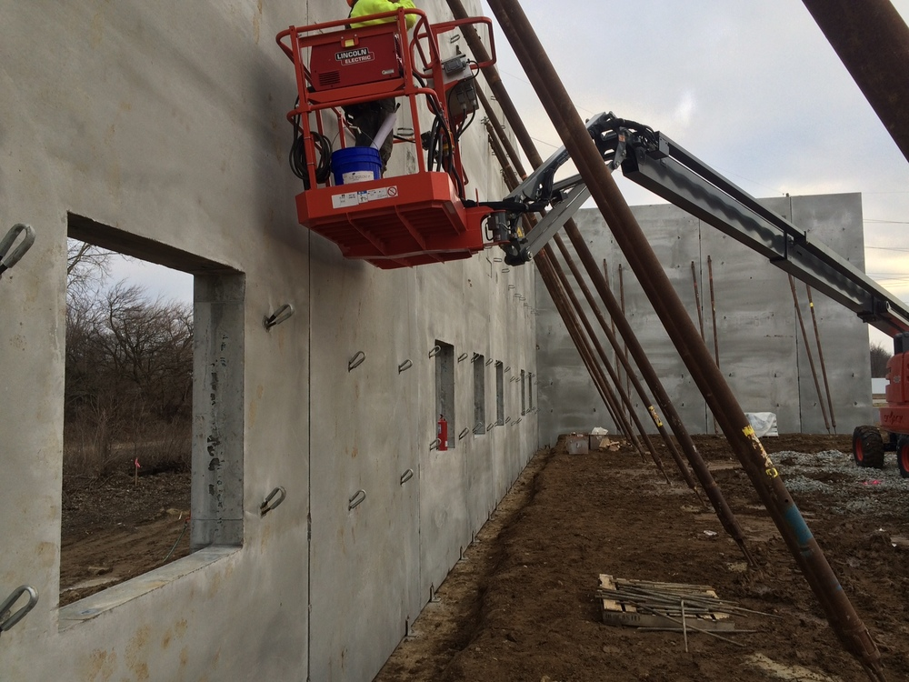 Start Installing Angles on Precast to Carry Steel Joist.JPG