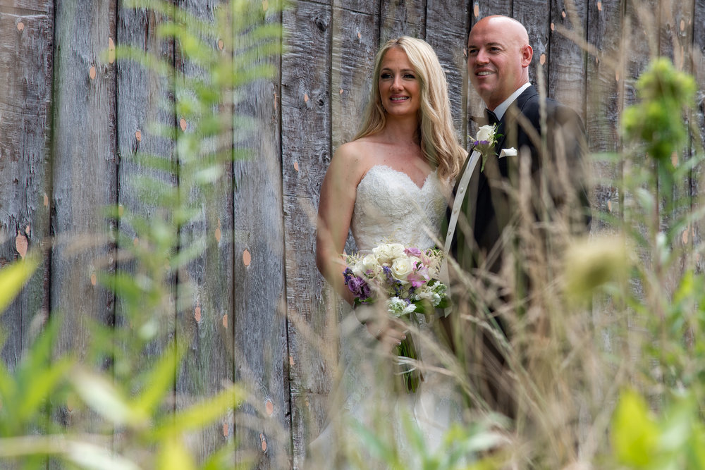 Bride and Groom in Flowers at Maneely's