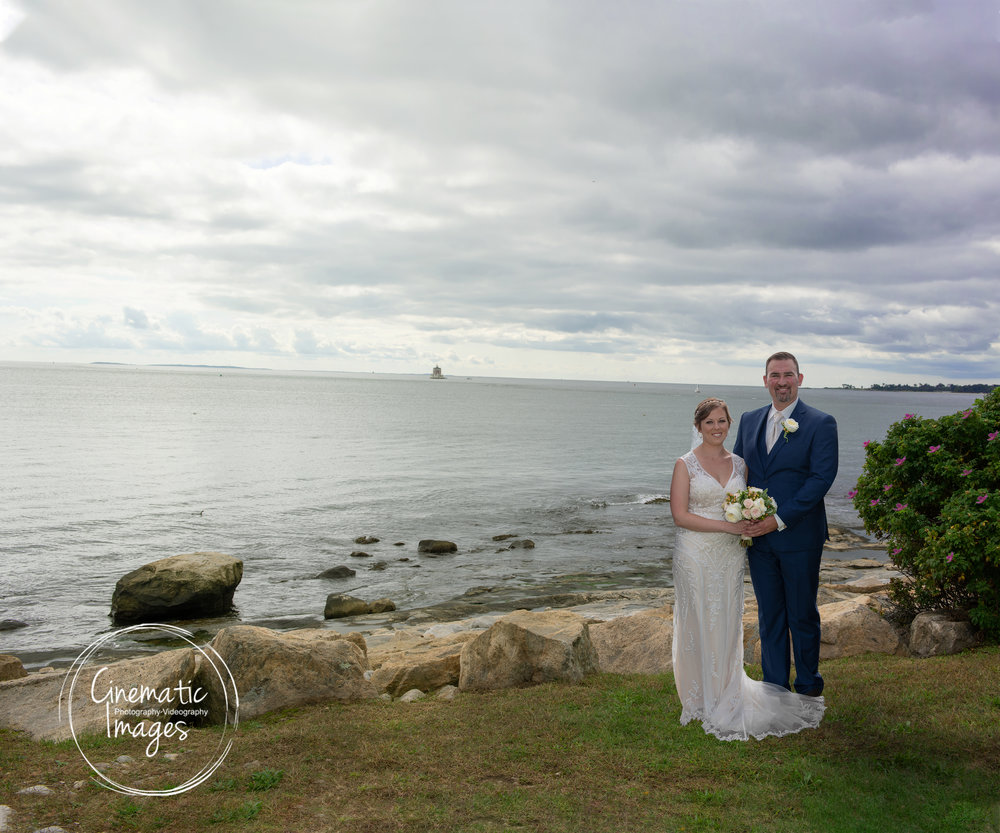 BRIDE AND GROOM NEAR OCEAN