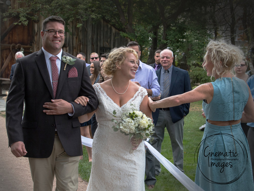 BRIDE'S AUNT GIVES LOVING TOUCH AS SHE WALKS UP THE AISLE