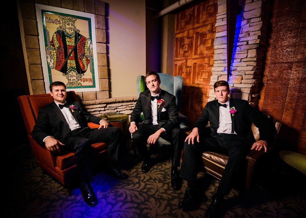 Dapper groomsmen in the underground lounge a.k.a. Speakeasy.