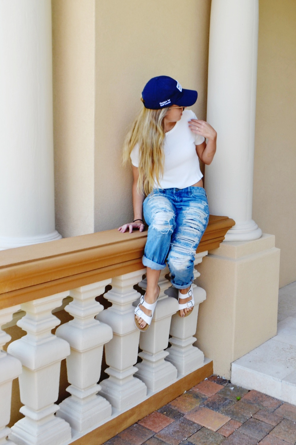 hat: a local country club; shirt: brandy melville; jeans: [BLANKNYC]; shoes: Steve Madden; sunglasses: Burberry