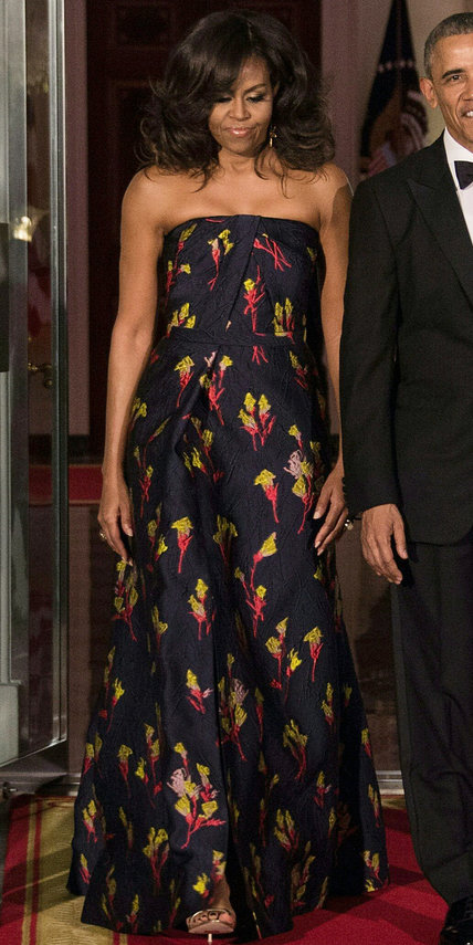 In a custom Jason Wu gown – strapless   midnight  blue dress featuring an elaborate floral jacquard pattern and asymmetrical draping – for a White House State Dinner