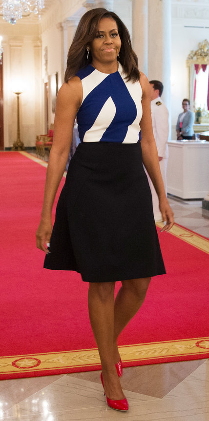 Obama wore a silk blue and white top with a matching crepe black skirt to the National Medal for Museum and Library Service award presentation at the White House