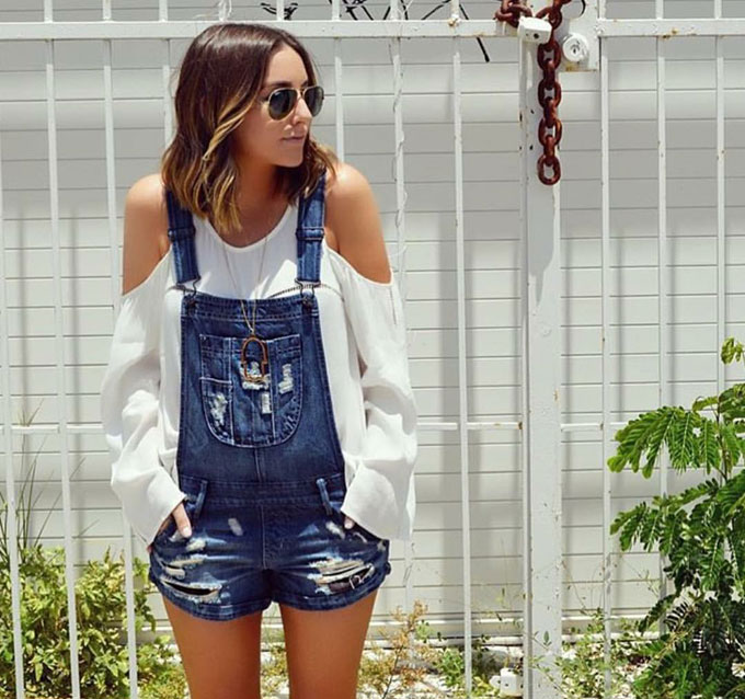 Matching trends- cut-out sleeves with distressed dungarees.