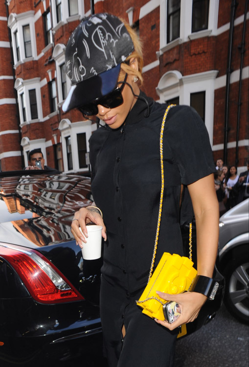 Rihanna holding Boy Brick Clutch