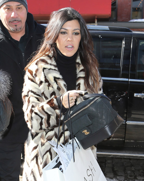 Kourtney Kardashian carrying Chanel Train Case