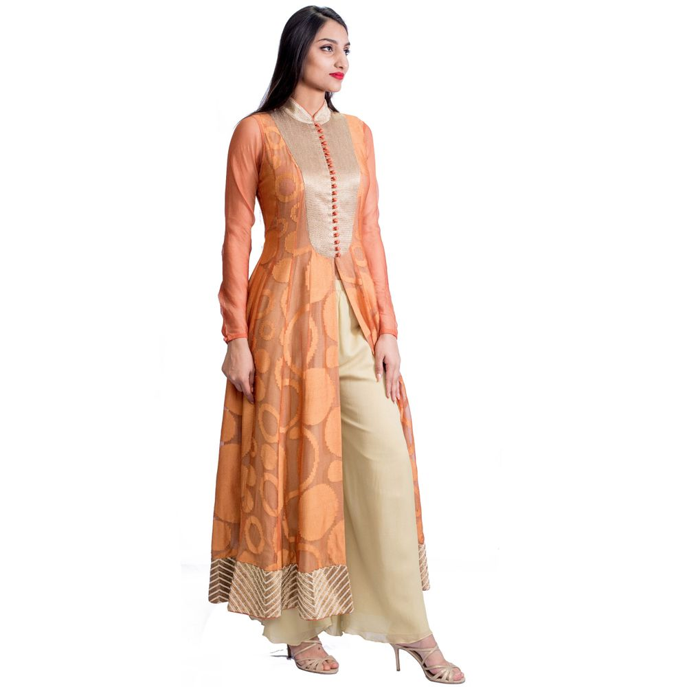 This orange front-open kurta by Dev R Nil is going to be your life-saver! Pair it with cream palazzo or cigarette pants. Step into a pair of gold strappy heels.