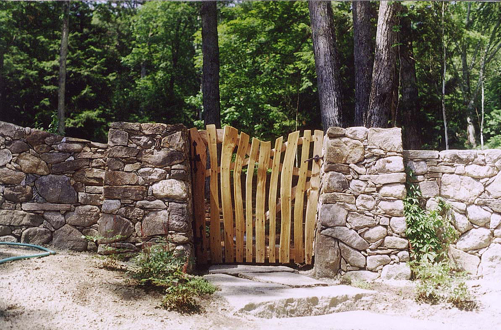 outdoor_wooden_gate_stone_fence.JPG