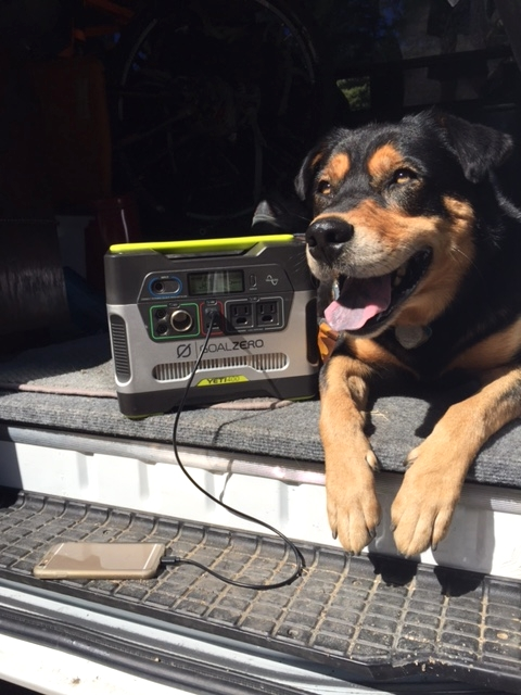 Mello recharges after a quick trail run while devices recharge on our Goal Zero Yeti 400.