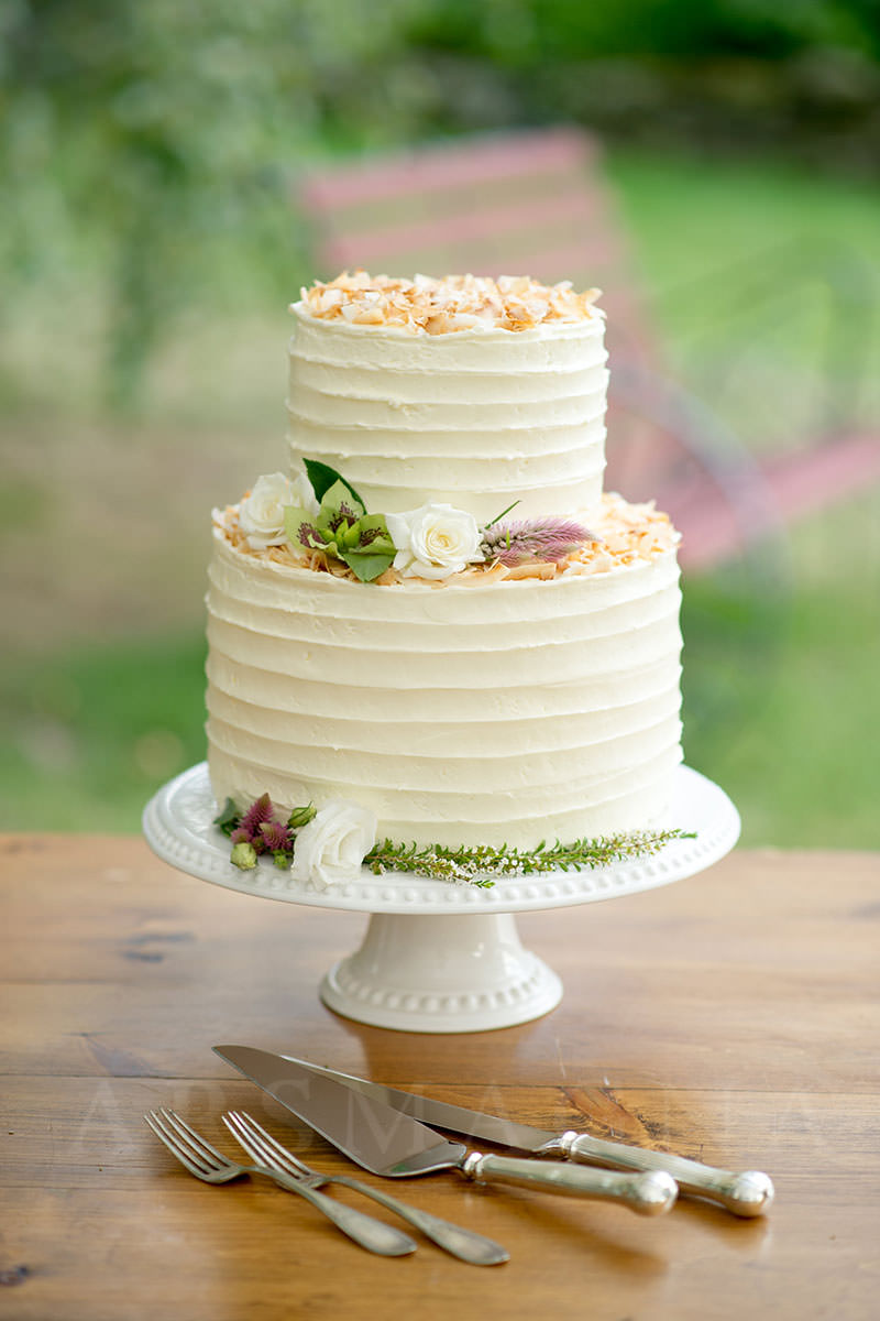 Chocolate buttermilk cake with coconut buttercream, topped with toasted coconut. Killer. ©Ars Magna Studio
