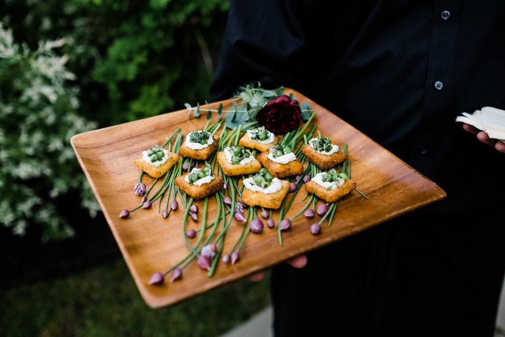 Crispy polenta cakes with ricotta, spring peas, and herbs. ©Lisa Rigby