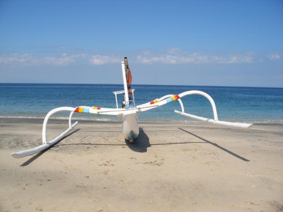 traditional Balinese boat on beach.JPG