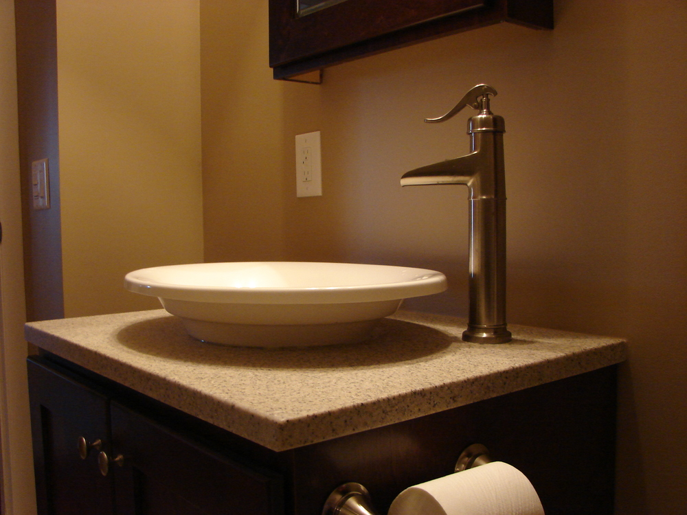 Cultured Marble top made by Cambria, with vessel sink and moen faucet. Very nice work