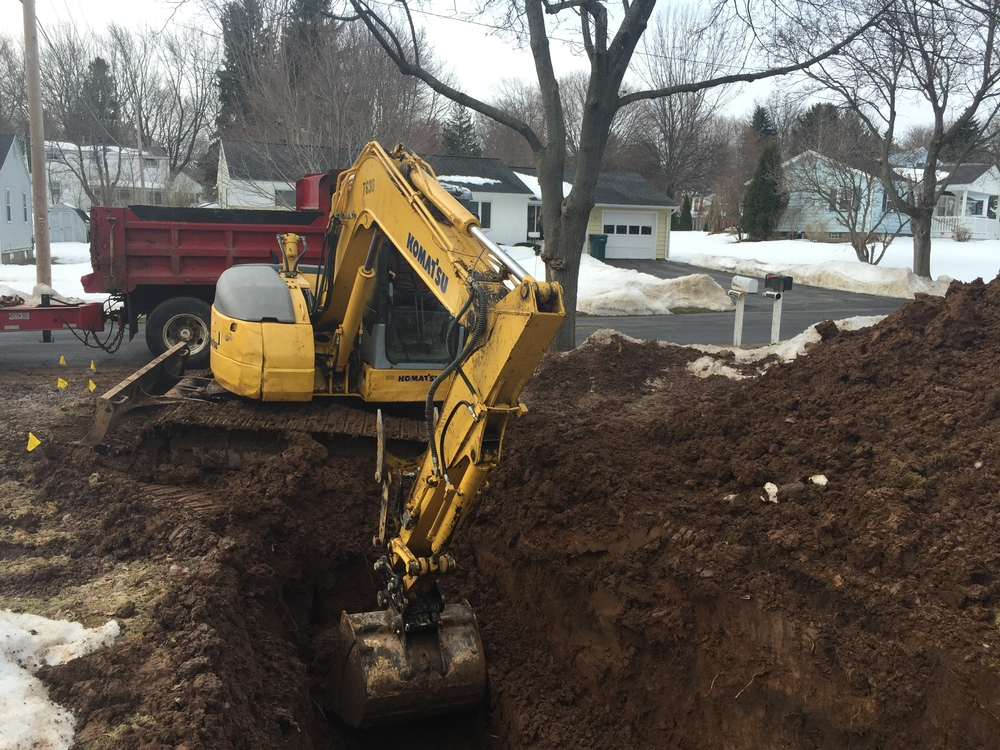 Digging a deep hole to fix a sewer