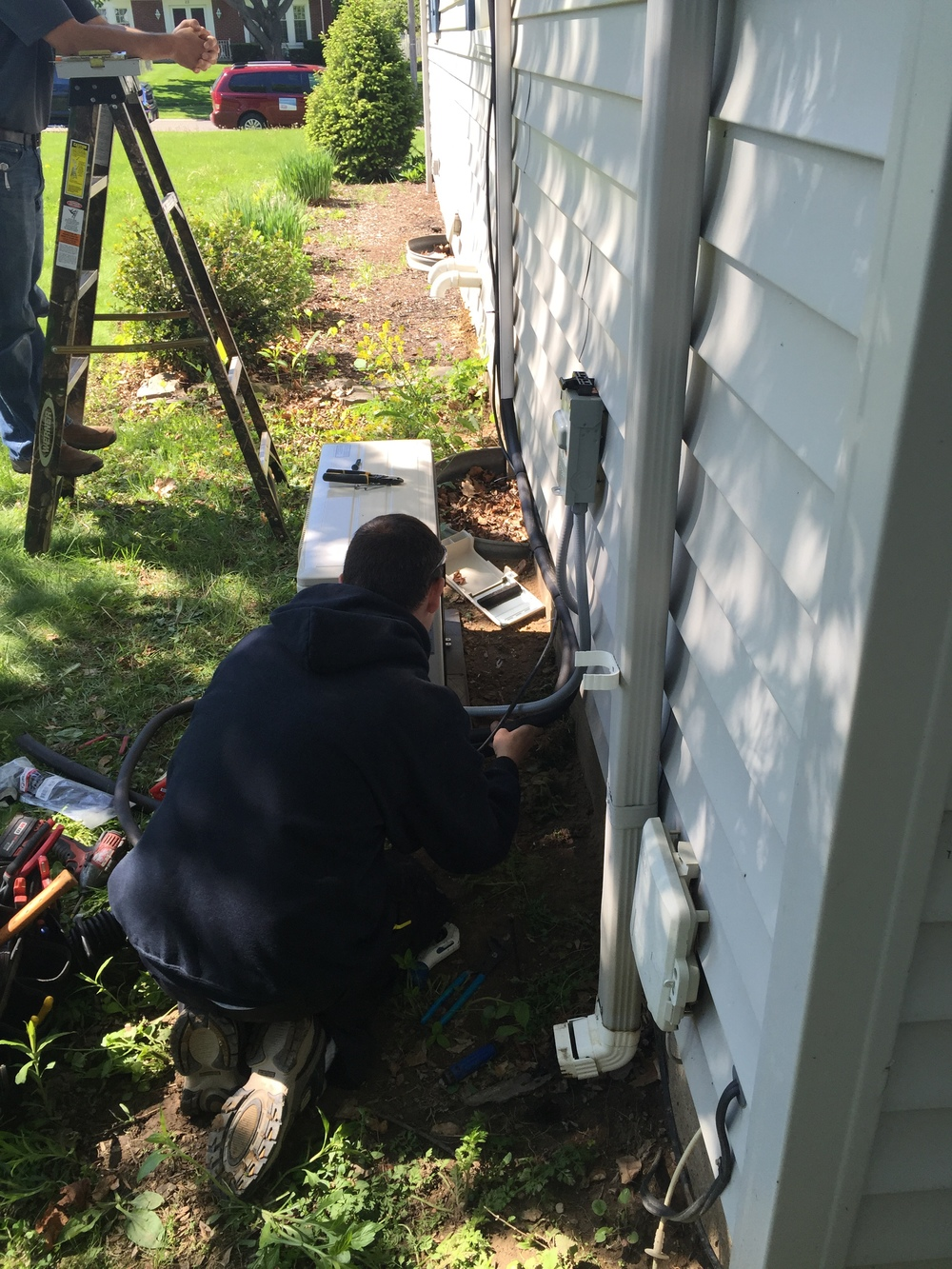 Mitsubishi Ductless Air Conditioner being installed in Greece, NY