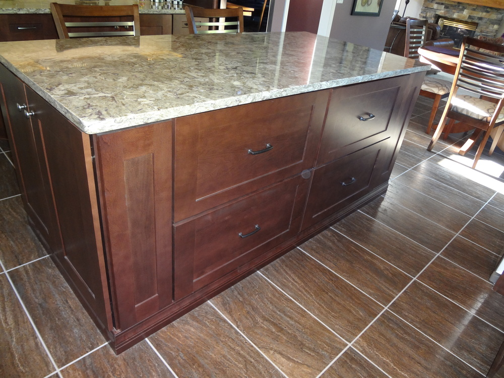 Bertch Cabinets make up this island with customer solid surface tops by Cambria.