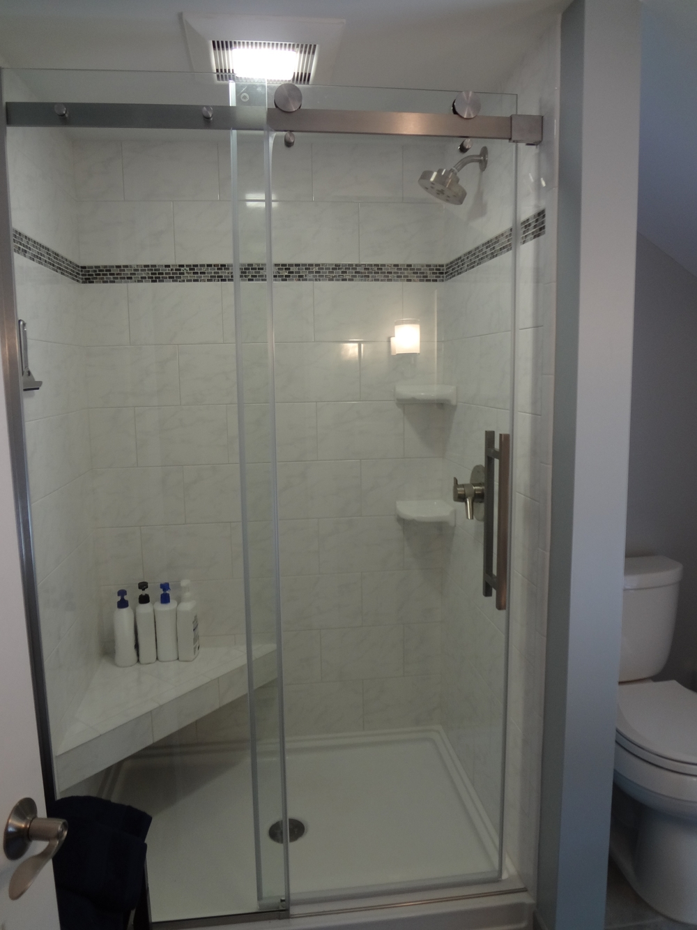 Beautiful tiled shower that has been expanded to allow for more room.