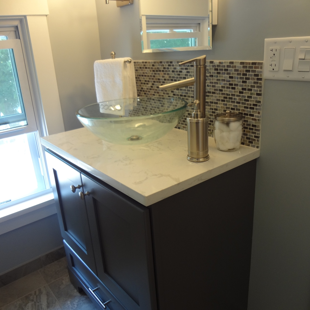 New Bertch Vanity with vessel sink, Cambria tops and tile backsplash.
