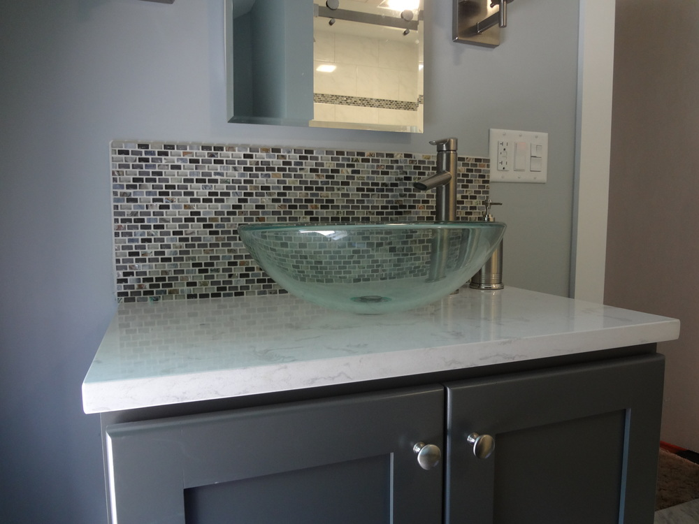 Very modern looking new sink, faucet and vanity top