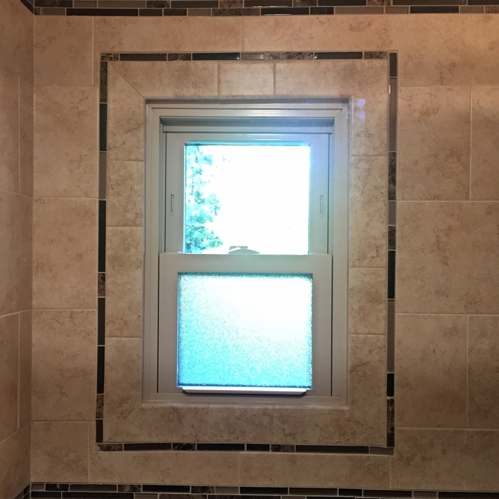 We installed a new replacement window and we used tile to create a truly unique look.