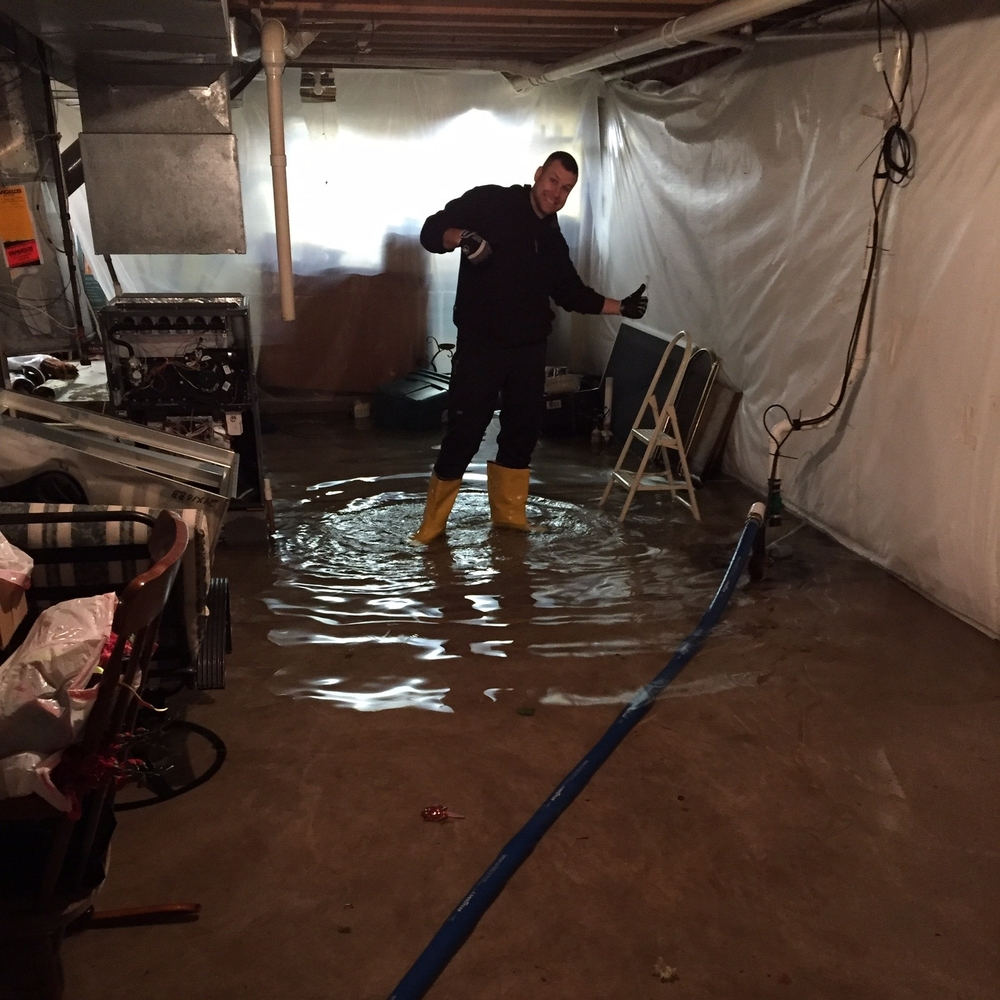 Josh Lavey - Emergency pump out of a flooded basement.  He looks pretty stylish in those boots!