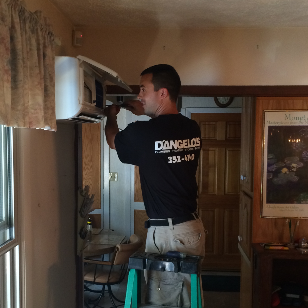 Gerry Blanchard performing a cleaning on a Mitsubishi Ductless Air Conditioning System.