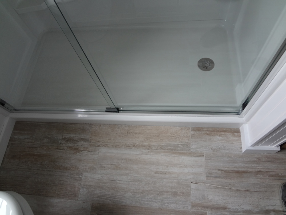 We removed the tub and replaced it with a new shower base and glass doors.