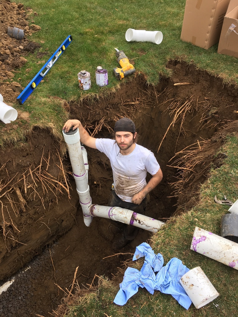 Carson installing a lot-line clean out.  This will allow easy access to the sewer in the future should a need arise.