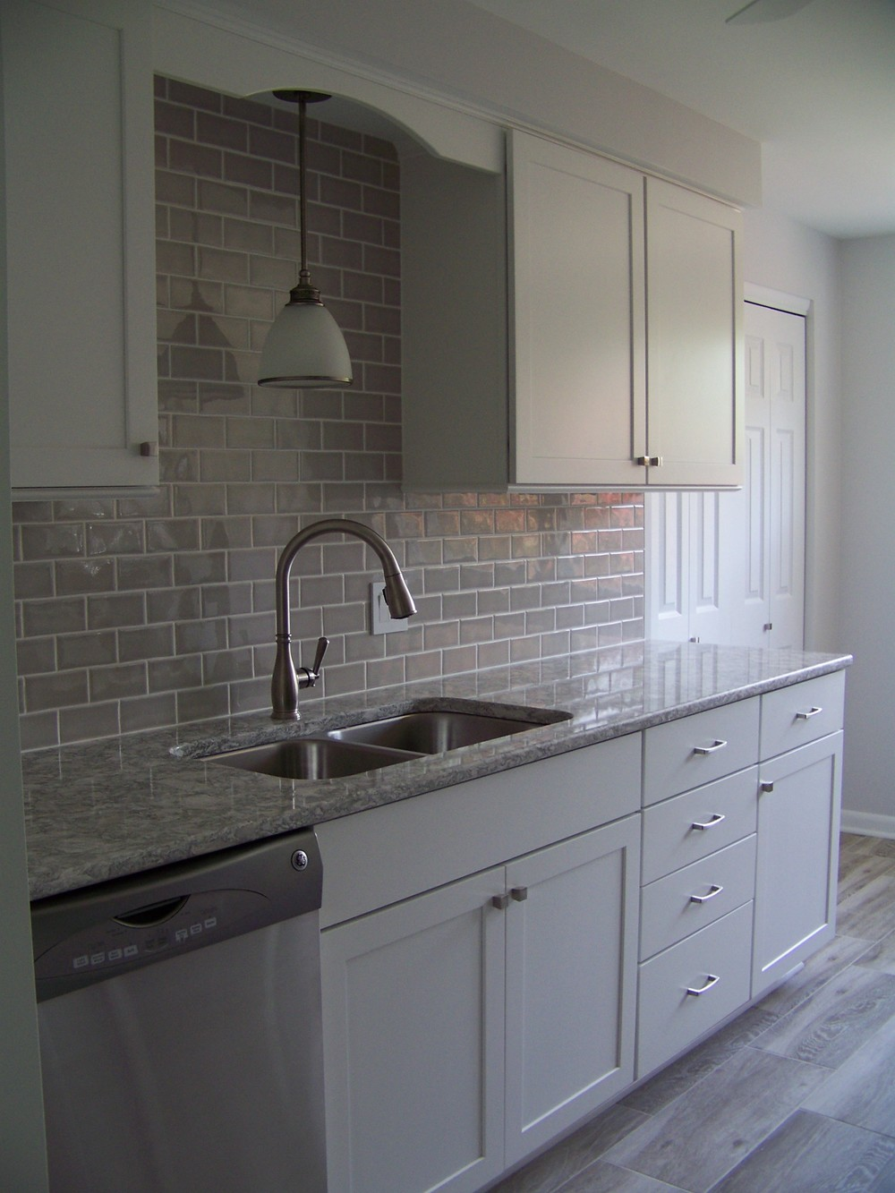 Diamond Vibe Cabinets, Cambria Quartz Tops, Subway Style Backsplash.